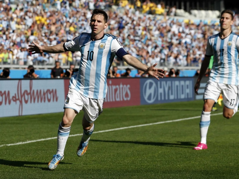 Argentinas Lionel Messi, left, celebrates after scoring during the FIFA World Cup match against Iran.