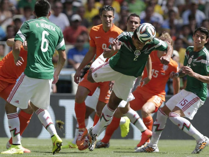 Netherlands and Mexico players in action in the Round of 16 of the FIFA World Cup 2014.