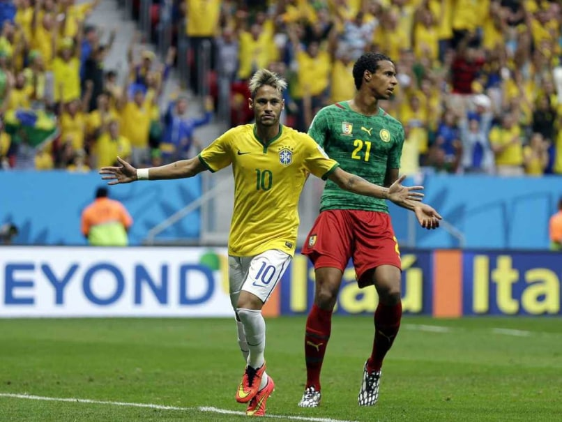 Neymar celebrates after scoring against Cameroon