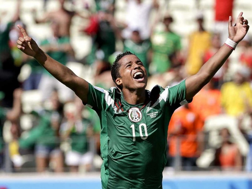 Giovani dos Santos celebrates after scoring for Mexico against Netherlands in the FIFA World Cup 2014 Round of 16 match.