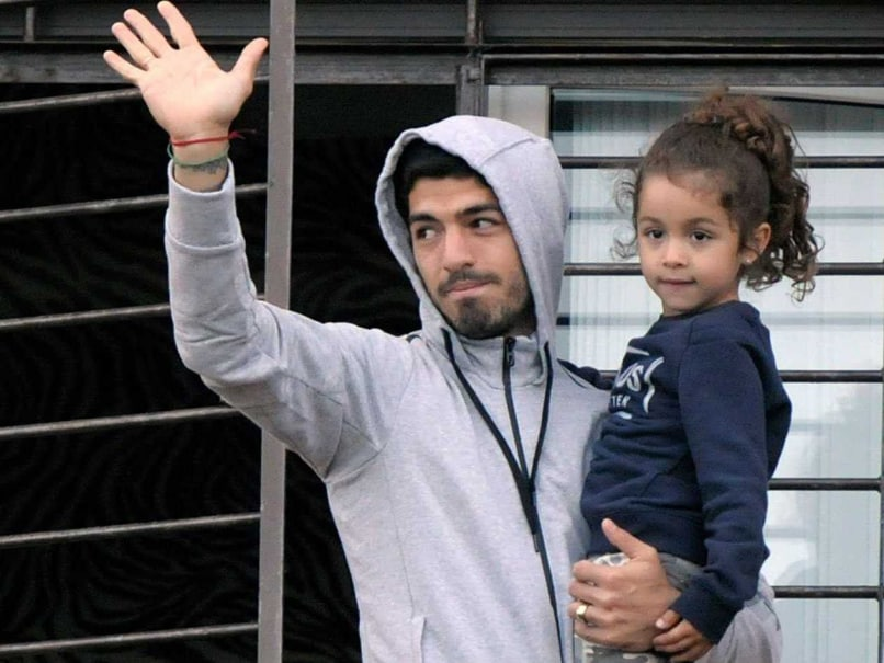 Upon Return to Uruguay, Suarez Is Met With Support