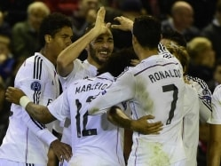 Real Madrid Sink Liverpool, Arsenal Escape With Late Winner