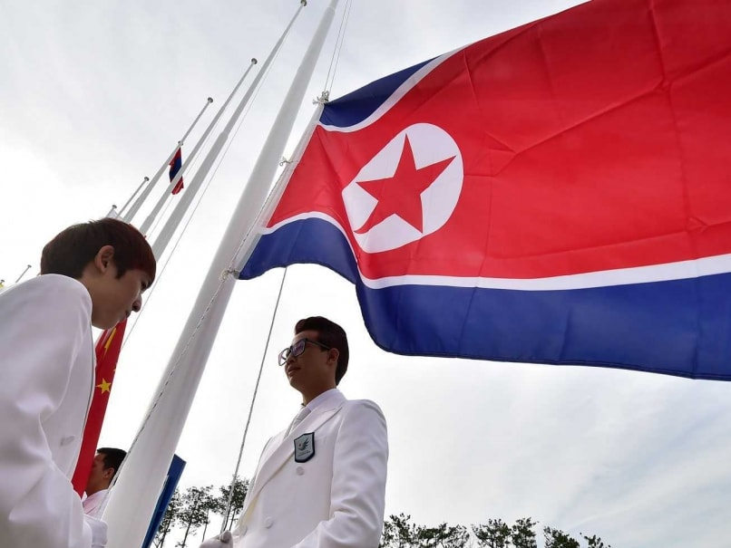 Asian Games 2014: Smiles and Scrums as North Korean Flag Goes Up at Incheon