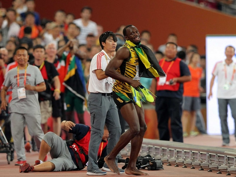 Usain Bolt Gets Knocked Over by Cameraman, Jokes By Saying Justin Gatlin
