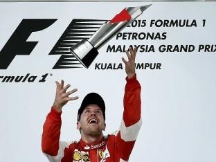 Malaysian GP: Sebastian Vettel Turns Air blue, Paints Town Red