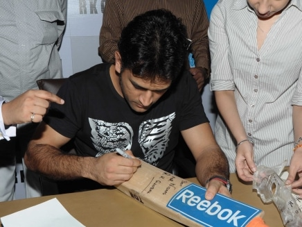 Image result for MS Dhoni's Guinness Book bat