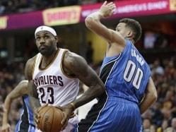 James Joins Robertson on NBA Elite List, Leads Cavaliers Past Magic
