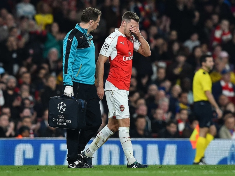 Arsenal F.C. Midfielder Aaron Ramsey Sidelined for a Month