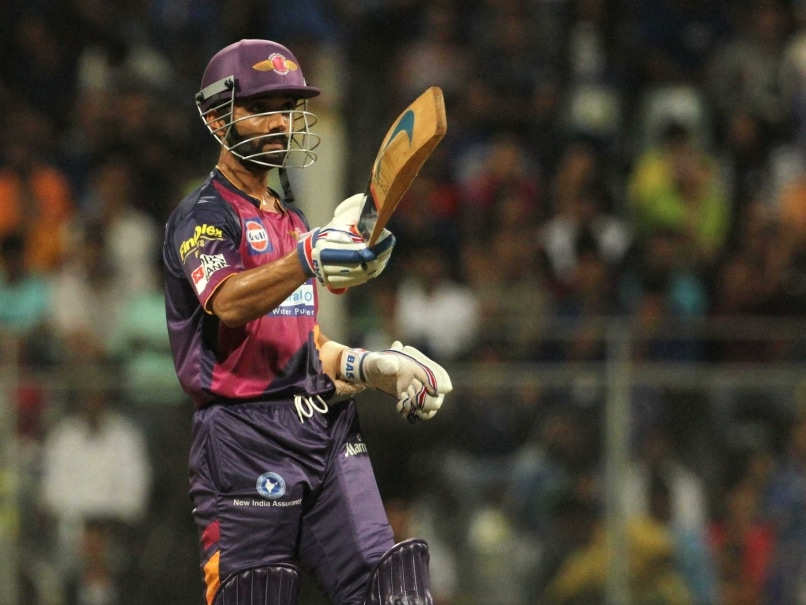 Rising Pune Supergiants player Ajinkya Rahane raises his bat after ...