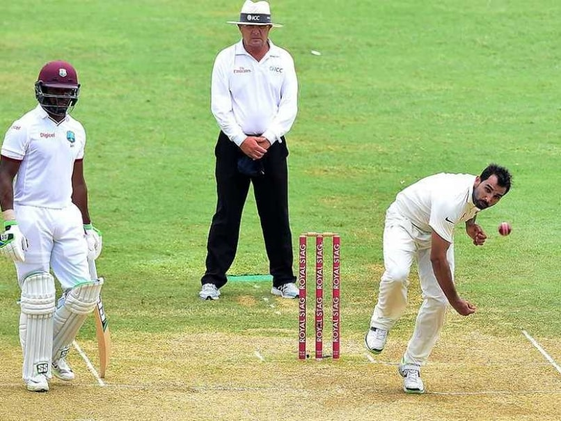 Pakistan's Misbah-ul-Haq shakes hands with West Indies captain Jason  Holder. AFP