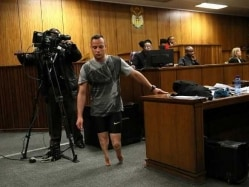 Oscar Pistorius Walks Minus Prosthetic Legs to Show Disability During Hearing