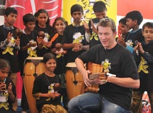 Brett Lee opens music studio for slum kids in Mumbai