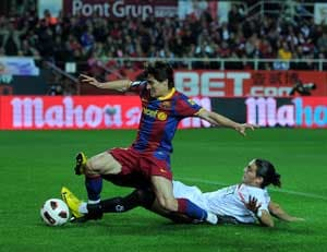 Title race hots up as Barca held by Sevilla