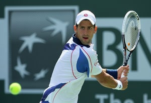 Djokovic crushes Gulbis, Jankovic out