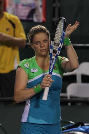 Clijsters back from brink in Miami escape