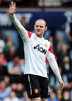 Rooney hat-trick as Man United down West Ham