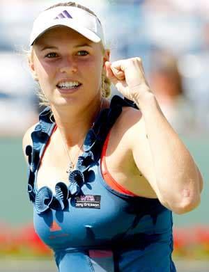 Wozniacki ends Martinez jinx in style