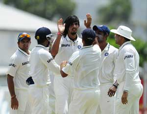 Rain plays spoilsport after Ishant's double strike