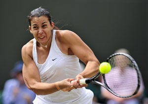 Marion Bartoli finds winning touch against Mallory Burdette
