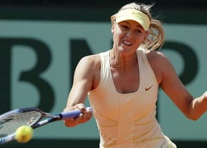 Sharapova through at tear-stained French Open