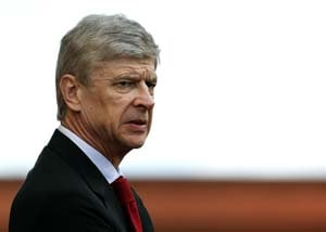 Wenger risks UEFA wrath over phone row