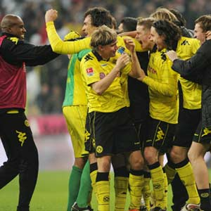 Dortmund dismiss title talk as party prep begins