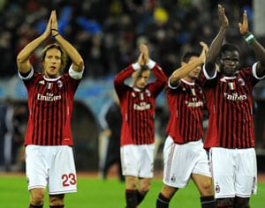 Milan inch closer to knockout phase