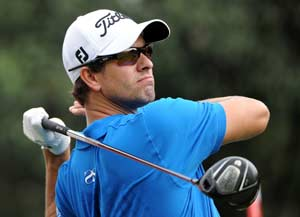 Scott stands by outspoken caddie over Woods slur