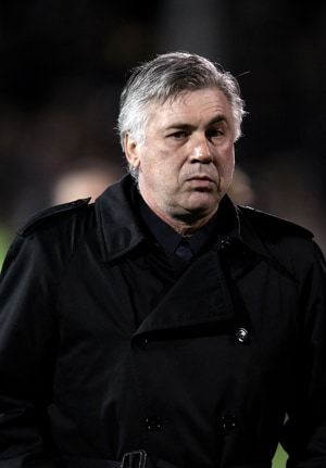 Ancelotti plays down talk of title