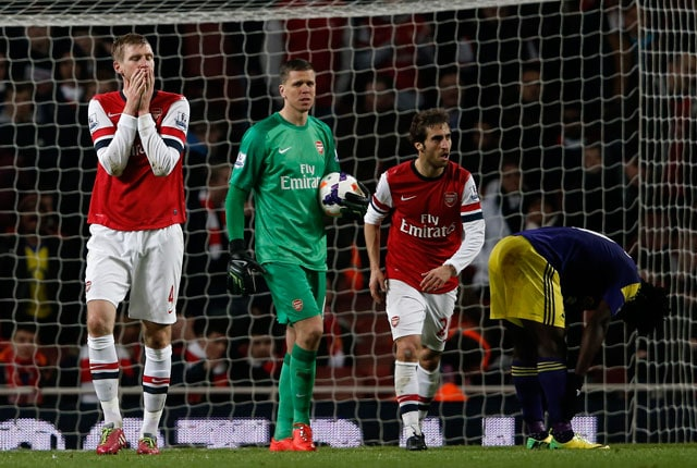 EPL: Arsenal F.C. title hopes hit after 2-2 draw against Swansea