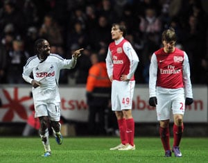 Swansea shock Arsenal, ruin Henry's Premier return