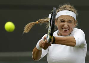Azarenka eases into second round at Wimbledon