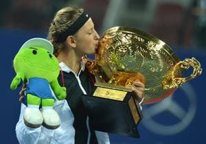 Azarenka thrashes Sharapova to win China Open
