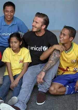 Beckham bonds with abused children