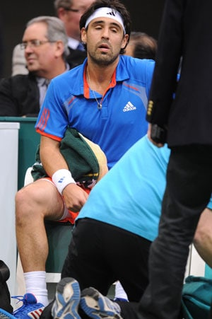 Berdych through at ABN Amro as Baghdatis retires