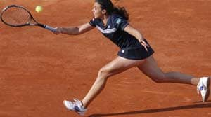 Bartoli into French Open second round