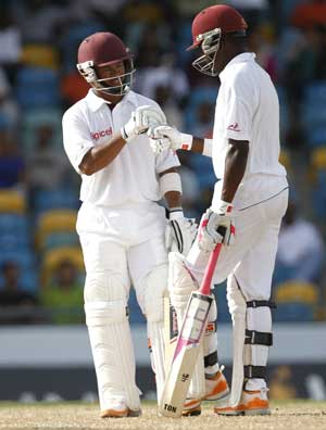 Bravo, Baugh deny India a victory