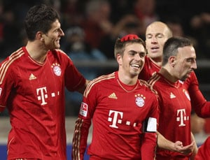 Bayern pull clear with win at 10-man Stuttgart
