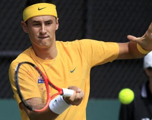 Bernard Tomic survives early scare in China