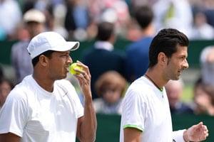 Wimbledon 2013: Bopanna, Bhupathi in doubles QFs; Sania exits women's doubles