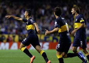 Boca stays in chase with 3-1 victory over Racing