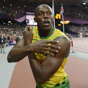 Bolt cruises, Blake storms to landmark 100m win