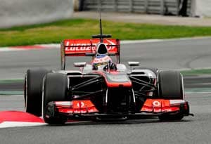 Jenson Button sets pace on second day of testing