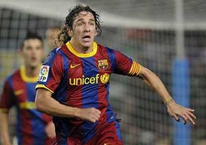 Puyol back in Barcelona for match against Santander