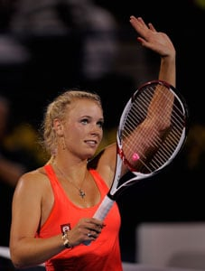 French Open: Caroline Wozniacki eases past Laura Robson