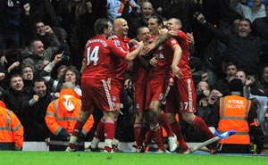 Carroll the hero as 10-man Reds sink Rovers