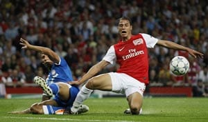 Arsenal ride luck to see off Olympiakos