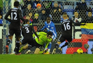 Chelsea stumble at Wigan after Cech howler
