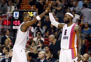 Bosh scores 30 to lead Heat past 76ers 113-92
