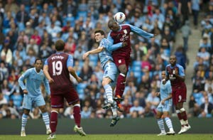 Manchester City go top after routing Villa